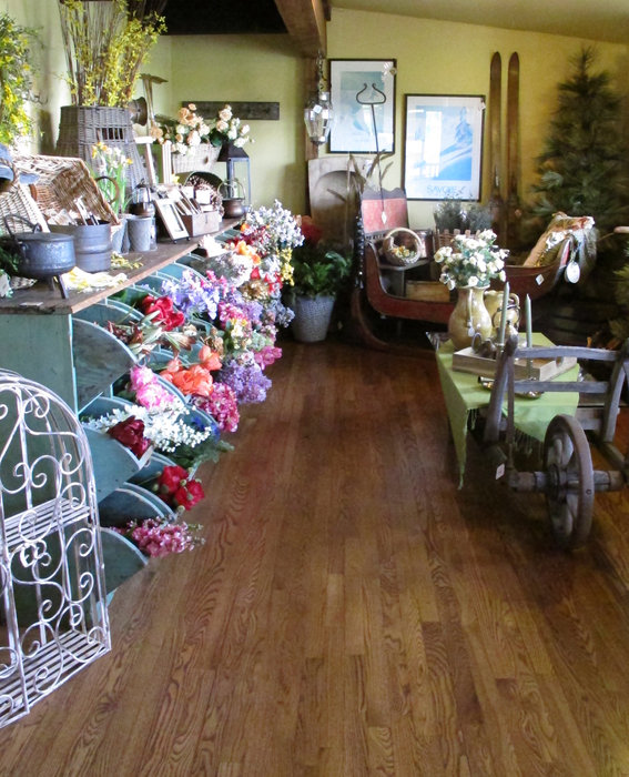 In addition to antiques, Ski Country Antiques & Home sells florals, artwork, lamps, throw blankets, pillows, rugs, candles, body care, scarves and books, to name a few. - © Heather B. Fried
