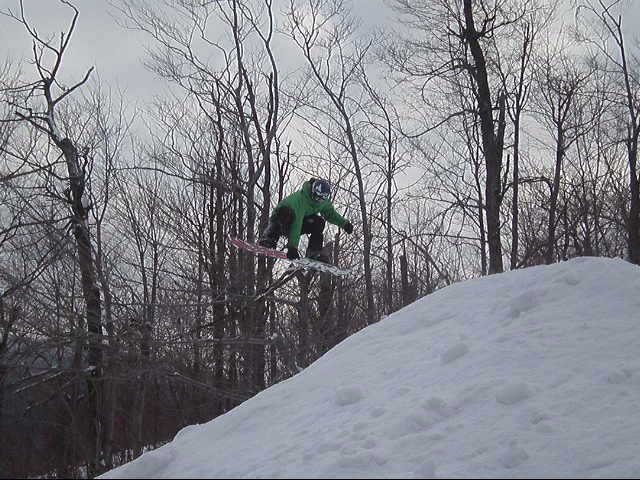 A snowboarder catching air at Whiteface, NY.