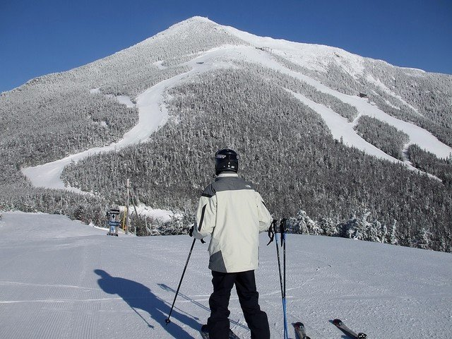 A skier surveying the landscape at Whiteface, NY.