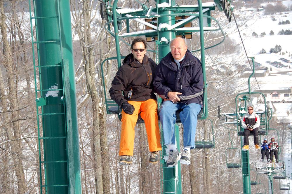 Stephen Kircher and Warren Miller on the Hemlock chairlift at Boyne Mountain, Mich.