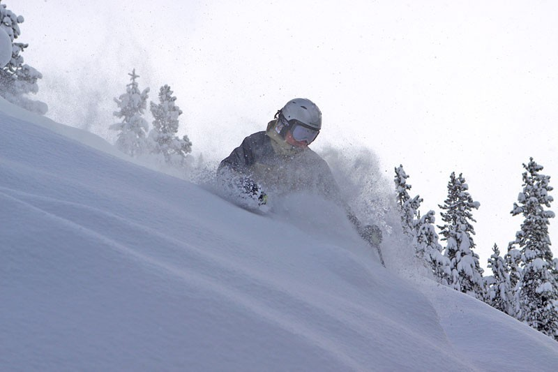 Skier in deep powder at Crested Butte, CO.