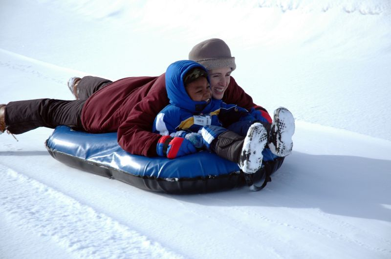 Mother and child tubing at Angel Fire, NM.