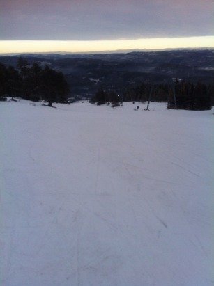 A lot of ice showing through - just enough snow to be skiable.