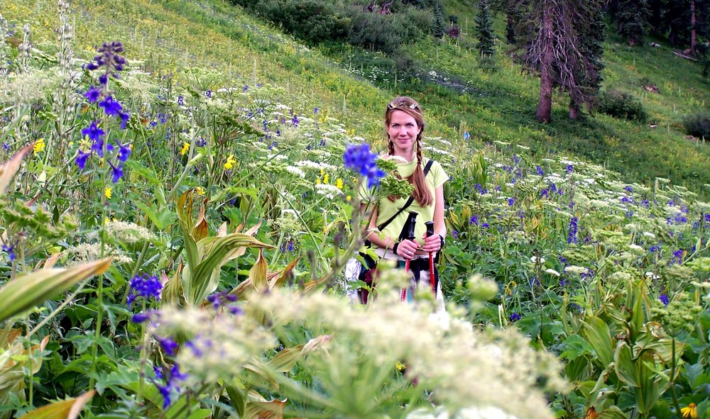 A hiker among wildflowers in Durango.