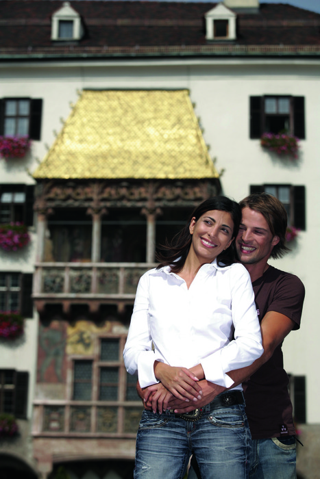 Couple by golden roof in Innsbruck town centre