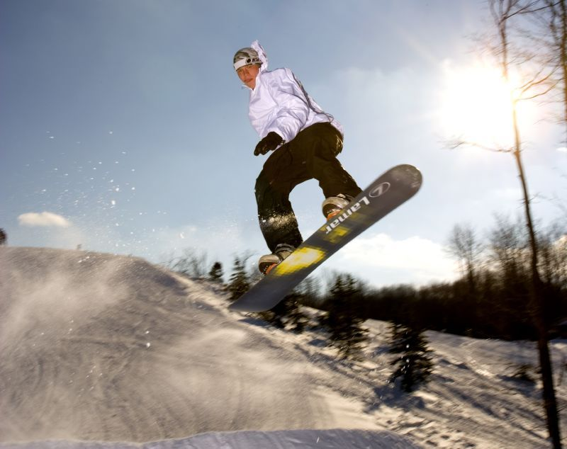 A snowboarder gets air in the terrain park, Shanty Creek Resorts, Michigan