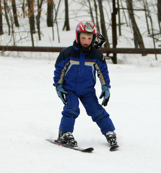 Young skier matriculating down a slope at Wild Mountain, MN