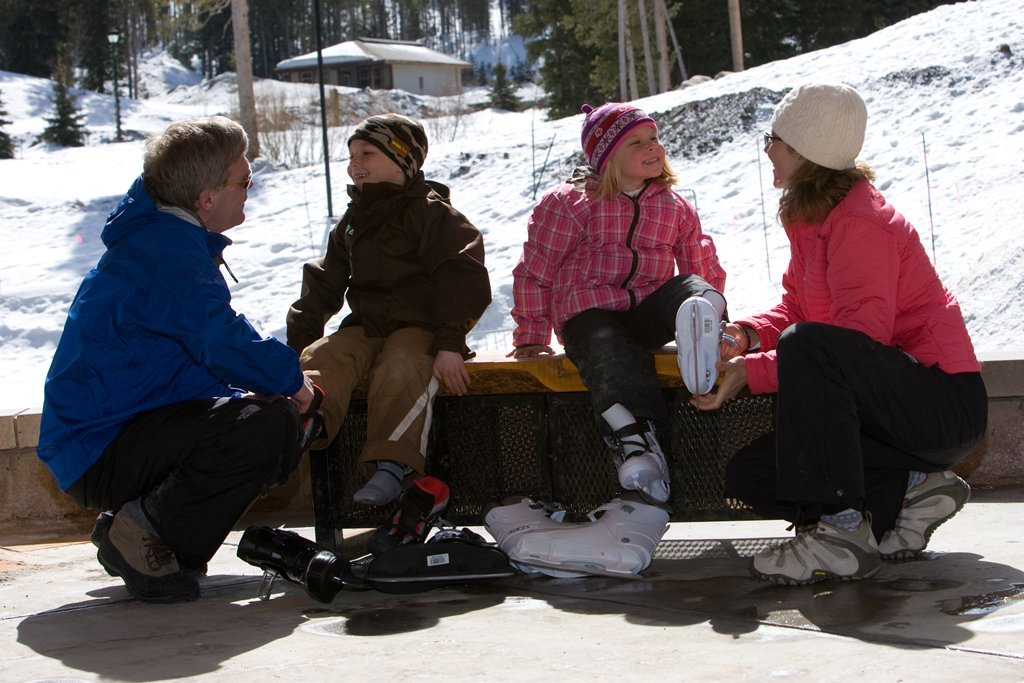 A family getting ready to ice skate at Winter Park, CO.