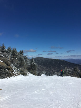 Smugglers' Notch Resort - Awesome spring bluebird day. Bit icy at the base but everything open from the summit down was great. Few inches of snow at the top was nice to ride today. They blew snow last night into the morning so had plenty to ride on. Winter isn't dead just yet! - © martyrd0m