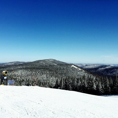 Tremblant - Bluebird skies on Tuesday.  Hardpack snow. Tremblant did an excellent job with what they had. Definately coming back next year.  - © Rick James iPhone