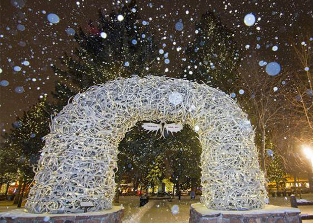 Snow falling on historic town square and the famous Antler Arches - © Jackson Hole Mountain Resort