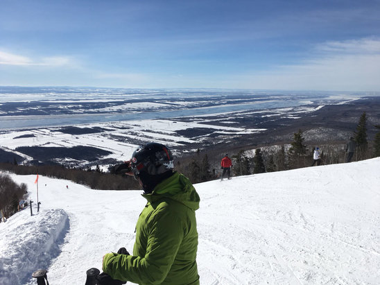 Mont Sainte Anne - Beautiful Tuesday Feb 21. No powder but great groomers. Lots of rain today and hill took a serious beating.  - © iPhone