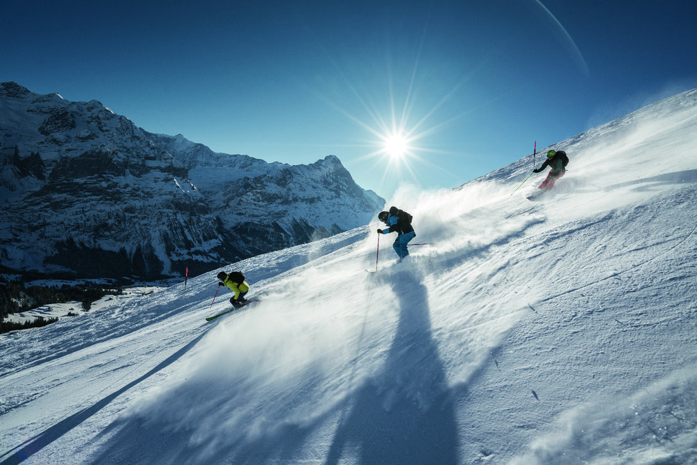 Skifahrer vor Eiger-Kulisse - © Jungfrau Region