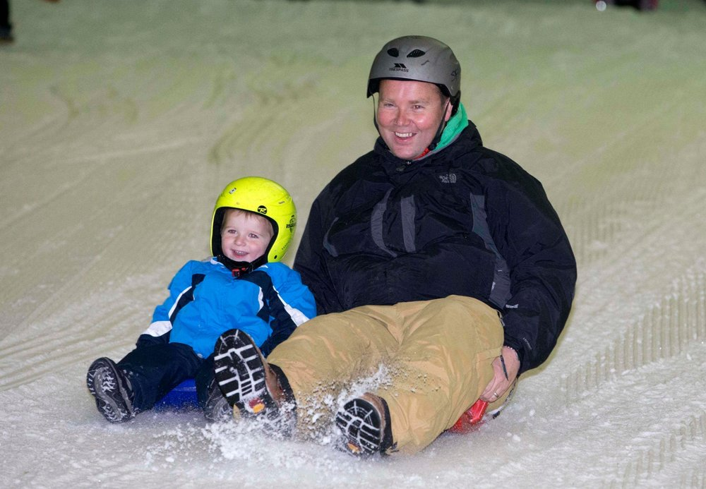 Family sledging at Snow Factor - © Jeff Holmes Photography