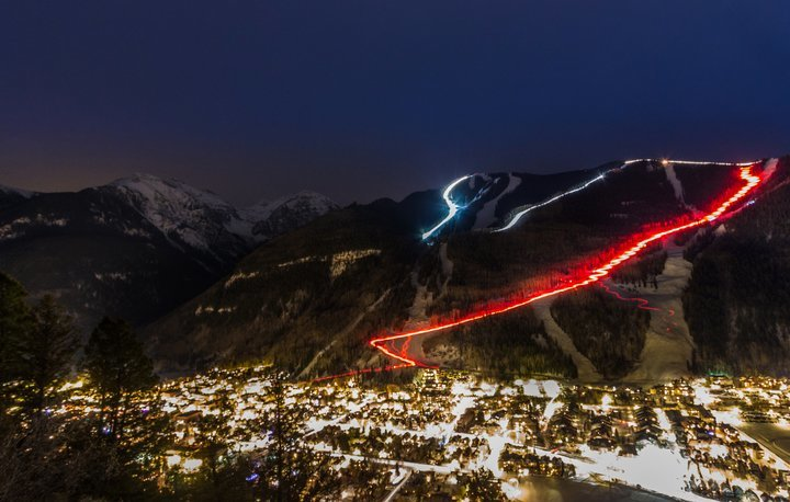 A Christmas Eve and New Year's Eve torchlight parade are fun holiday traditions in Telluride. - © Visit Telluride/Ryan Bonneau