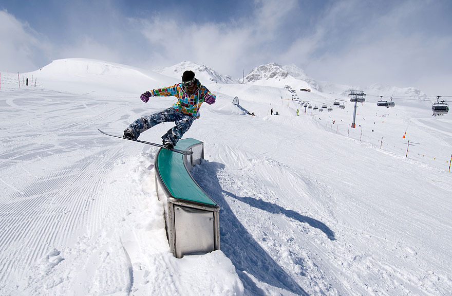 Snowboarder at Scuol, Switzerland terrain park.