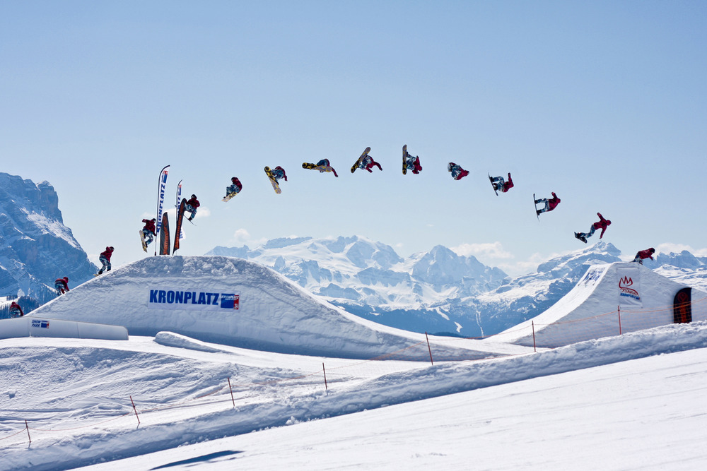 Freestyle snowboarder tricks at Kronplatz Snowpark, Austria,