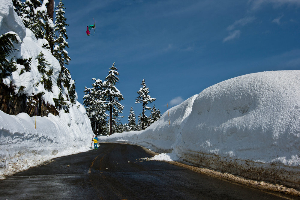 Kc Deane - road gap backflip at Mt. Baker - © Grant Gunderson