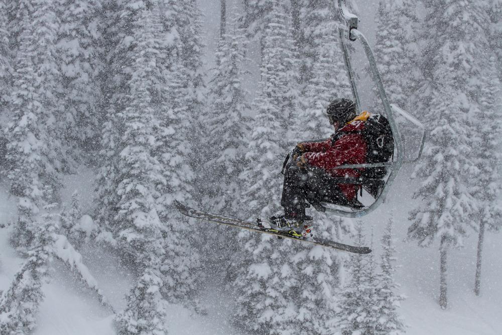 A lone ski patroller rides the Northway lift. - ©Liam Doran
