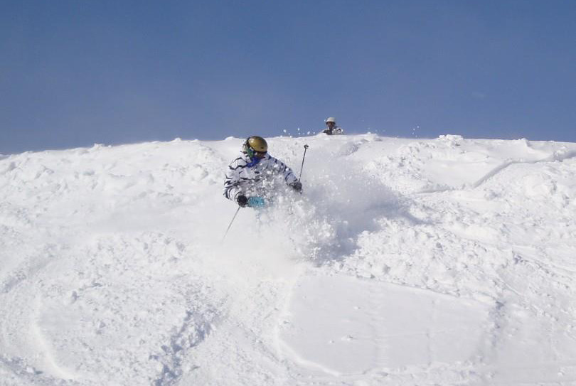 A skier finds a soft powder stash. Photo Courtesy of Winterplace Ski Resort.