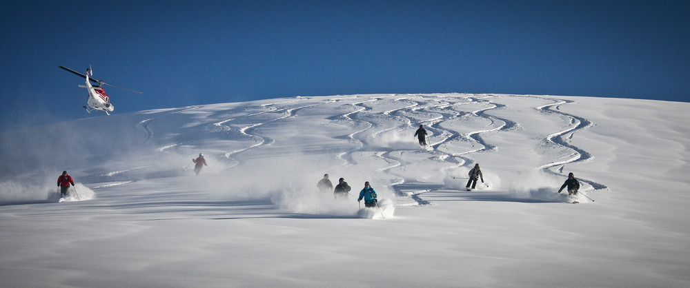 Group turns underneath the chopper at Tyax Lodge Heli-Skiing. - © Randy Lincks/Andrew Doran