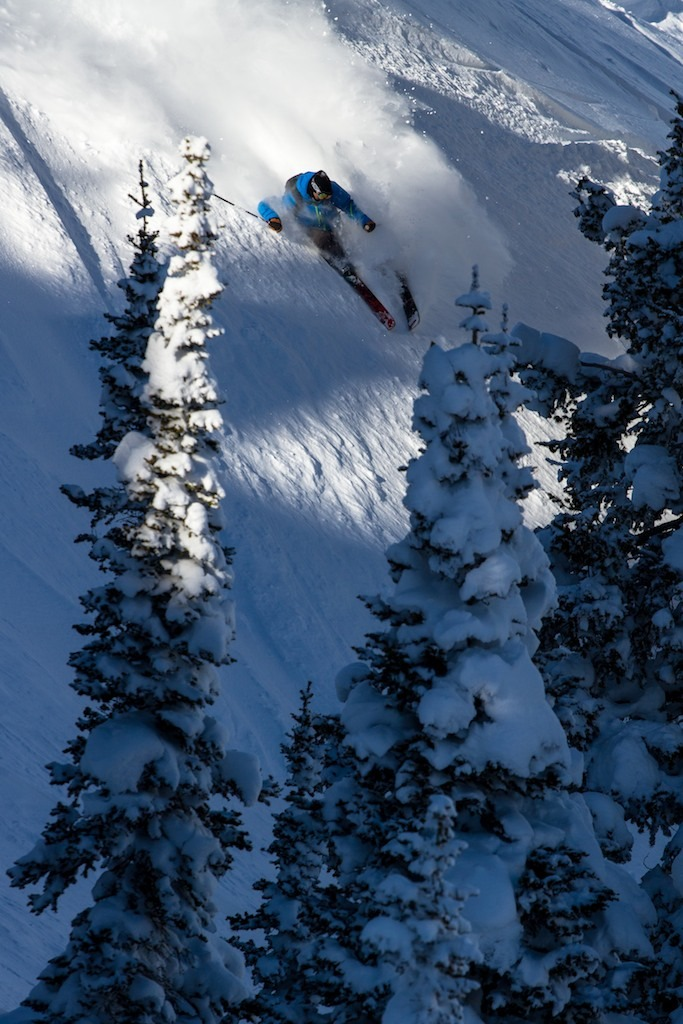Skier Todd Ligare finds pockets of light and snow in No Name trees. - © Liam Doran