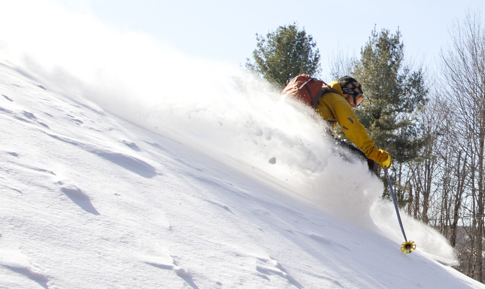 After a few nice runs in the backcountry, Twombly skis to lunch at a friend's house. - ©Brian Mohr/EmberPhoto