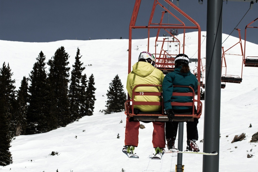 Getting cozy on the Mountain Chief lift. - © Liam Doran