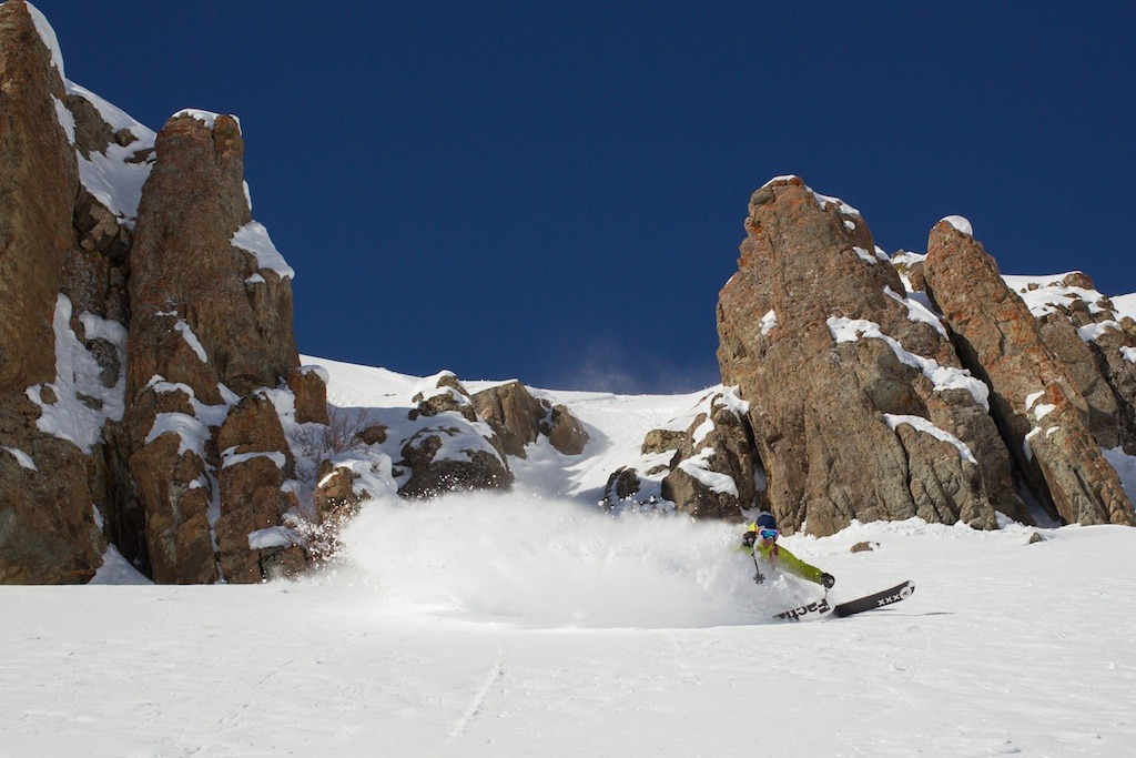 Brady Schlitchting slashes a turn at Irwin Cat Skiing at Eleven Colorado. - ©Jeff Cricco