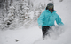 A snowboarder cuts through powder at Nakiska.
