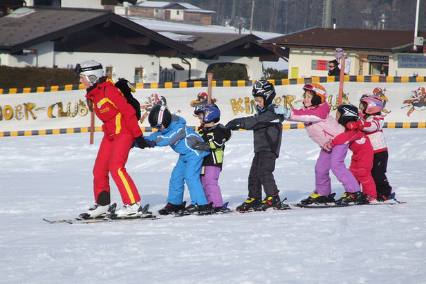 Children learning to ski in Ellmau, Austria.   - © Credit Andrew Dowsett