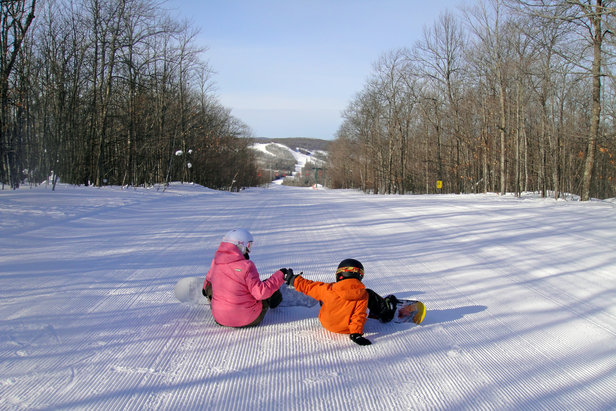 Fist bumpin' on a great day at Indianhead.  - © Indianhead Mountain Resort