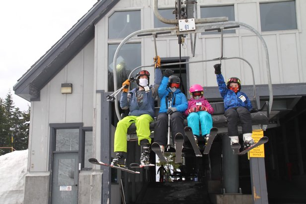 Skiers wear masks on the lift at Timberline Ski Area