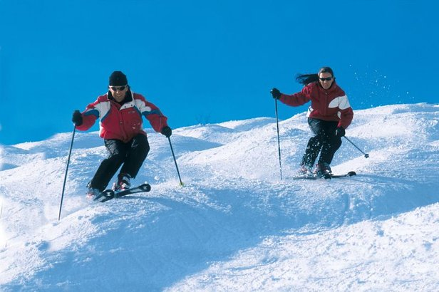Skiers cruise down Crystal Mountain, Michigan's slopes