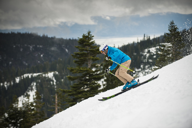 Skier making turns opening day at Squaw Valley